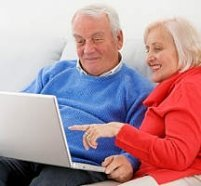 senior couple with laptop computer