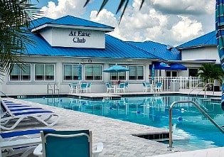 Clubhouse and pool at Indian River Colony Club 55+ for military