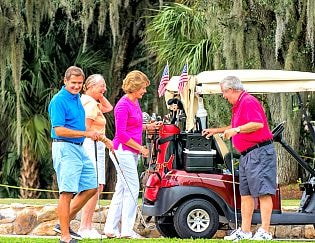 Indian River Colony Club golfers and cart