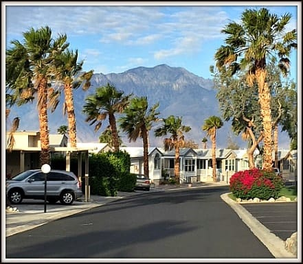Caliente Springs RV park model community street with mountain view