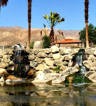 waterfall entrance to Caliente Springs in Desert Hot Springs CA