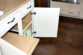 Courts of Clarksburg  with slide out drawers in kitchen.