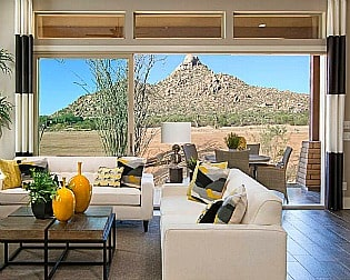Four Seasons at Scottsdale Heights model home living room with view of Pinnacle Peak