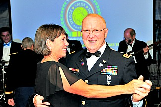 military couple dancing at social gathering