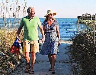 senior couple walking on beach at Myrtle Beach