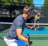 a pickle ball player at 55+ community by Kolter Homes